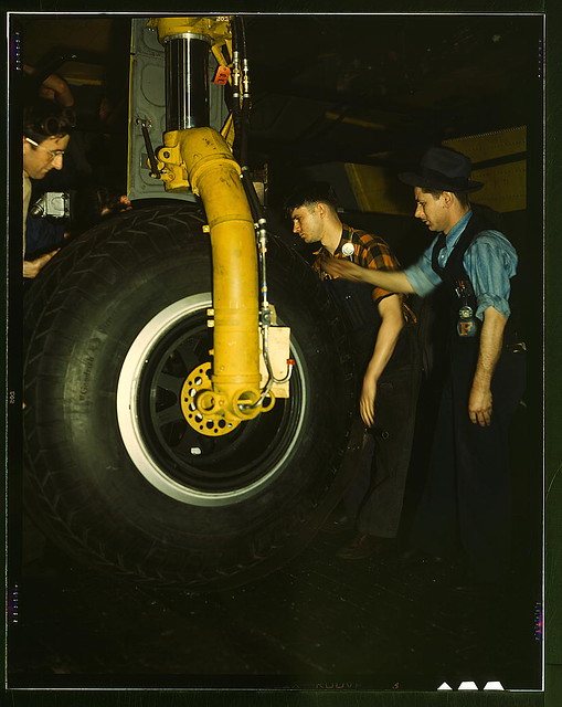 Inspecting of landing wheel of the transport planes at Willow Run  (LOC)