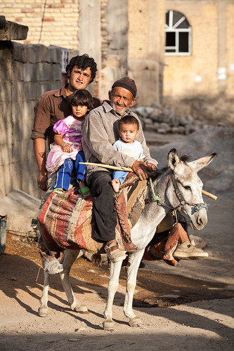 people ass animal animals rural standing outside outdoors person daylight stand persian day sitting afternoon village ride iran outdoor muslim islam religion middleeast donkey places burro riding human sit beast shia iranian creatures creature mammals humanbeing magichour beasts humans goldenhour kaj villager humanbeings shiite equusasinus domesticatedanimals shiaislam chaharmahalandbakhtiariprovince domesticass chaharmahalandbakhtiari