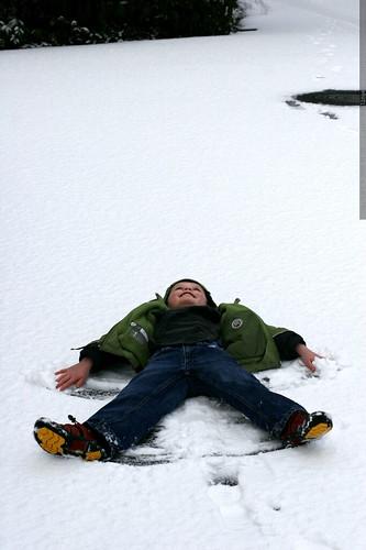 nick making a snow angel    MG 9437