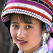 Portrait of woman with traditional hat. China