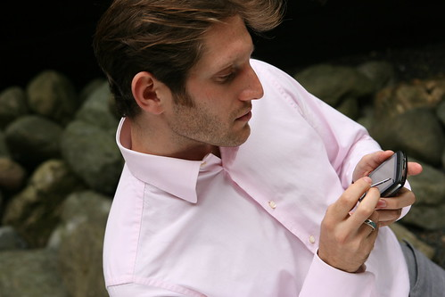 Man using Windows Mobile device with stylus outside