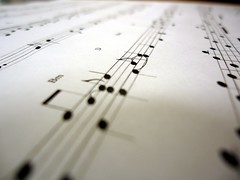 hand(0.0), handwriting(0.0), writing(0.0), number(0.0), musical instrument(0.0), guitar(0.0), design(0.0), string instrument(0.0), sheet music(1.0), white(1.0), music(1.0), line(1.0), close-up(1.0),