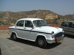 gaz-21(0.0), automobile(1.0), automotive exterior(1.0), vehicle(1.0), hindustan ambassador(1.0), compact car(1.0), antique car(1.0), sedan(1.0), classic car(1.0), land vehicle(1.0),