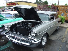 chevrolet bel air(0.0), convertible(0.0), automobile(1.0), automotive exterior(1.0), 1957 chevrolet(1.0), vehicle(1.0), compact car(1.0), antique car(1.0), sedan(1.0), vintage car(1.0), land vehicle(1.0), luxury vehicle(1.0), motor vehicle(1.0),