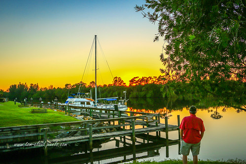 sun sunset water waterway okeechobee okeechobeewaterway boat sailboat tree man colorful dock docks seascape landscape stuart florida nature mothernature recreation recreationarea stlucielockdam outdoors outside