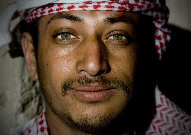 Green eyed man with keffiyeh chewing qat - Sanaa - Yemen