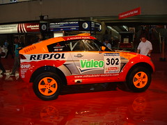 model car(0.0), dirt track racing(0.0), off-roading(0.0), race track(0.0), world rally championship(0.0), toy(0.0), auto racing(1.0), automobile(1.0), rallying(1.0), racing(1.0), vehicle(1.0), stock car racing(1.0), sports(1.0), race(1.0), motorsport(1.0), rallycross(1.0), rally raid(1.0), world rally car(1.0),