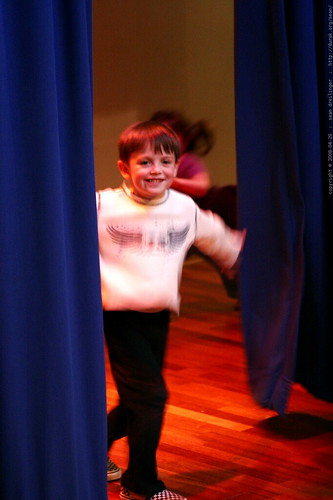 nick on stage, emerging from the curtain    MG 1883