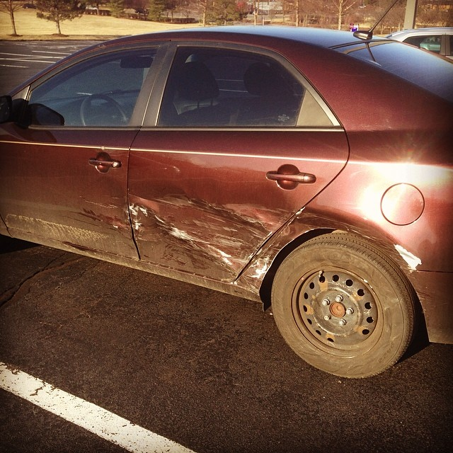 Damage to car from 12-March-14 accident.