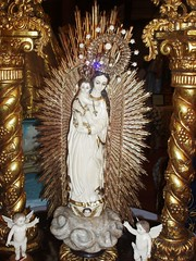 Ivory Del Rosario in a  carved retablo