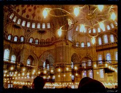 Eyes uplifted in the Blue Mosque