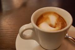 hong kong-style milk tea(0.0), salep(0.0), food(0.0), espresso(1.0), cappuccino(1.0), flat white(1.0), cup(1.0), cortado(1.0), coffee milk(1.0), caf㩠au lait(1.0), coffee(1.0), ristretto(1.0), coffee cup(1.0), caff㨠macchiato(1.0), caff㨠americano(1.0), drink(1.0), latte(1.0), caffeine(1.0),