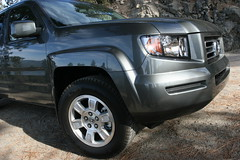 automobile(1.0), automotive exterior(1.0), wheel(1.0), vehicle(1.0), compact sport utility vehicle(1.0), honda ridgeline(1.0), rim(1.0), honda(1.0), bumper(1.0), land vehicle(1.0),
