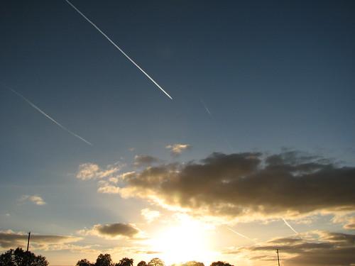 sky sun clouds plane dark landscape bright horizon trails poles polarizer telegraph polariser