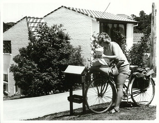 Postwoman delivering mail to a Titirangi home (214 Golf Road)