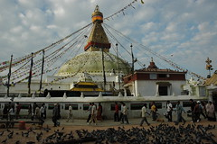The Great Stupa Jarung Kashor, as seen from the north side, people and pigeons, double dorje, candle offering shrine, Boudha, Kathmandu, Nepal