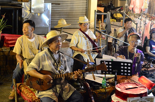Playing traditional Thai songs along the street.