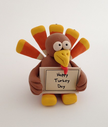 "Turkey with ""Happy Turkey Day"" Sign"