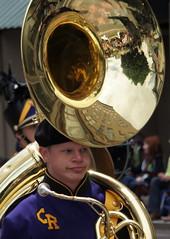 soldier(0.0), tuba(0.0), horn(0.0), sousaphone(1.0), musician(1.0), musical instrument(1.0), music(1.0), brass instrument(1.0), person(1.0),