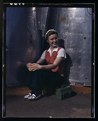 A noontime rest for a full-fledged assembly worker at the Long Beach, Calif., plant of Douglas Aircraft Company. Nacelle parts for a heavy bomber form the background  (LOC)