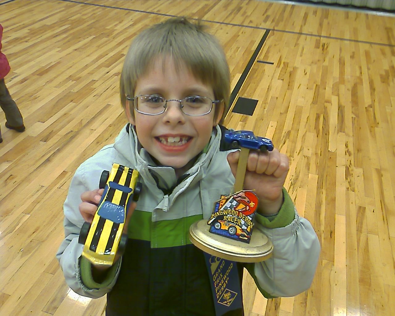 Matthew With His First Place Pinewood Derby Car And Trophy A