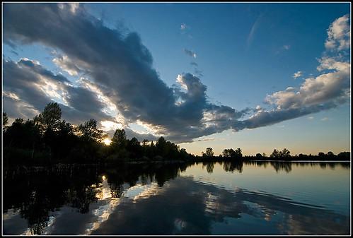 sunset sky sun lake cold reflection water clouds relax lago mirror nikon bravo tramonto nuvole silence cielo modena sole acqua riflessi cava specchio emiliaromagna gravelpit 10faves campogalliano d80 nikonstunninggallery 25faves