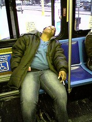 "A Drug Addict Sleeping or ""nodding off"" while Riding  the Bus"