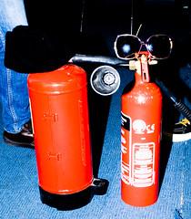 bottle(0.0), drink(0.0), orange(1.0), red(1.0), fire extinguisher(1.0),