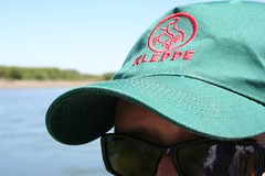 glasses(1.0), clothing(1.0), green(1.0), hat(1.0), cap(1.0), baseball cap(1.0), blue(1.0), sunglasses(1.0), headgear(1.0),