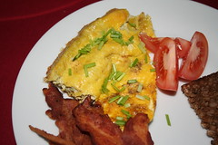 Omelet with bacon and tomatoes