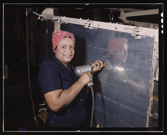 "Operating a hand drill at Vultee-Nashville, woman is working on a ""Vengeance"" dive bomber, Tennessee (LOC)"