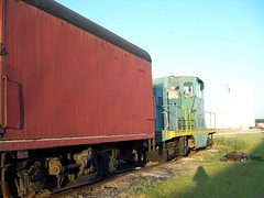 passenger(0.0), shipping container(0.0), passenger car(0.0), vehicle(1.0), train(1.0), transport(1.0), rail transport(1.0), freight car(1.0), locomotive(1.0), rolling stock(1.0), cargo(1.0), track(1.0), land vehicle(1.0), railroad car(1.0),
