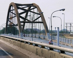girder bridge(0.0), public transport(0.0), truss bridge(0.0), cantilever bridge(0.0), overpass(0.0), skyway(0.0), cable-stayed bridge(0.0), tied-arch bridge(1.0), handrail(1.0), transport(1.0), iron(1.0), arch bridge(1.0), bridge(1.0),