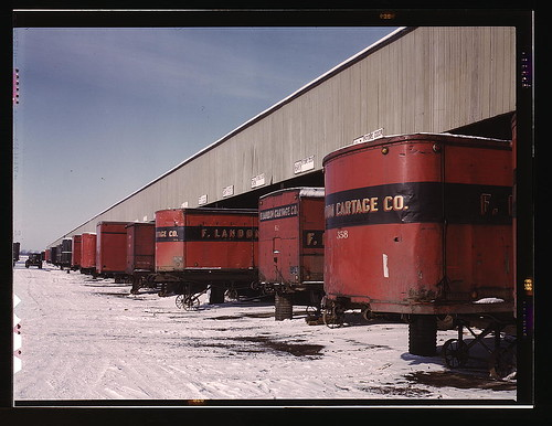 Truck trailers line up at a freight house to load and unload goods from the Chicago and Northwestern railroad, Chicago, Ill.  (LOC)