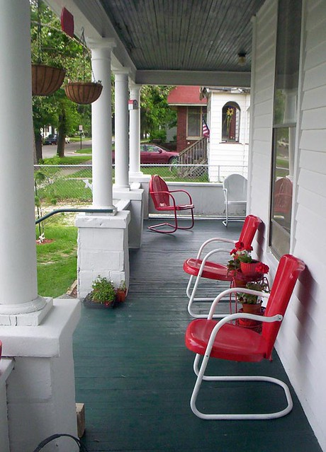 Red metal chair on the porch ideas