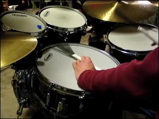 Playing drums with brushes