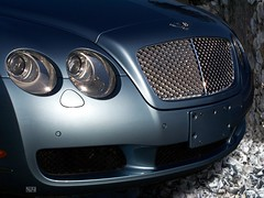 wheel(0.0), rim(0.0), automobile(1.0), automotive exterior(1.0), bentley continental supersports(1.0), vehicle(1.0), automotive design(1.0), bentley continental gtc(1.0), bentley continental flying spur(1.0), grille(1.0), bentley continental gt(1.0), bumper(1.0), personal luxury car(1.0), land vehicle(1.0), luxury vehicle(1.0), bentley(1.0),