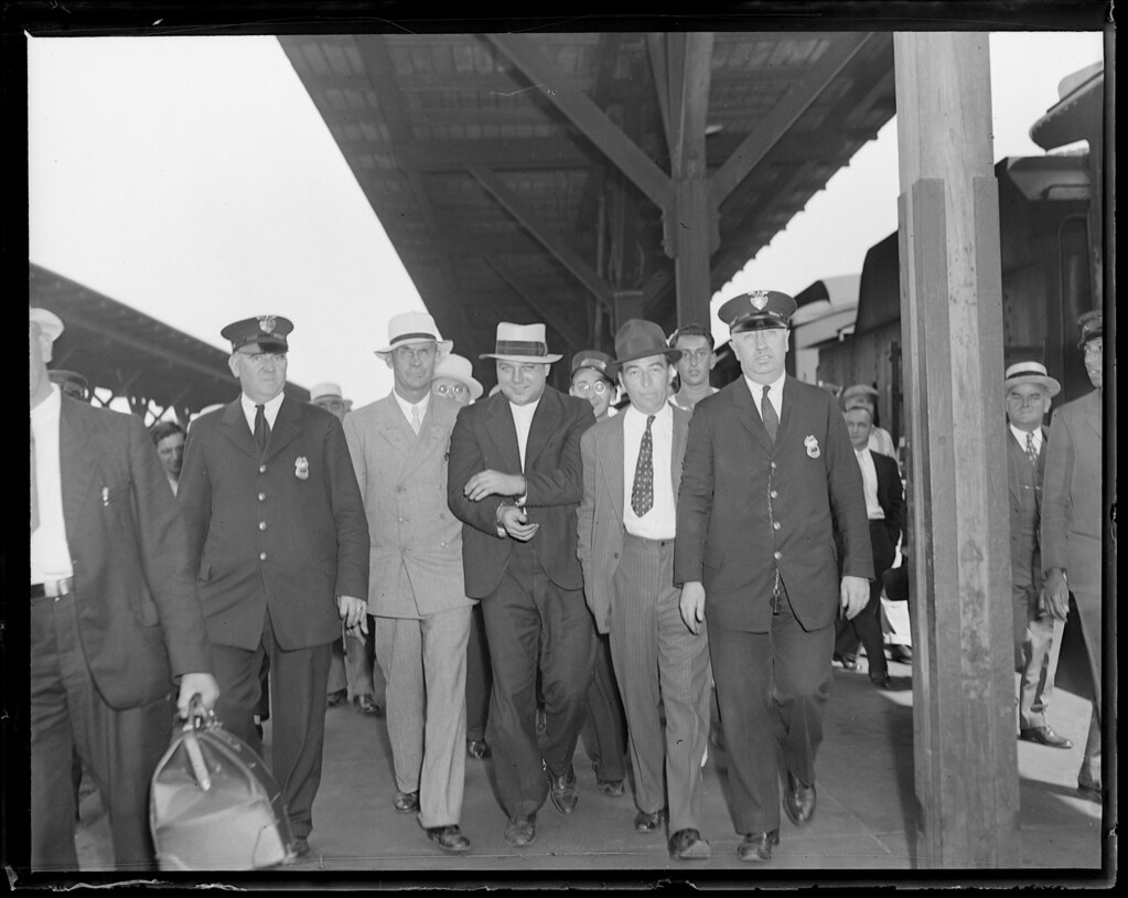 Theodore Bentz, Dillinger gang member, brought through Boston train station on his way to Michigan after capture in Portland