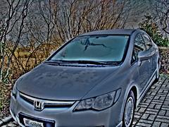 automobile(1.0), automotive exterior(1.0), wheel(1.0), vehicle(1.0), automotive design(1.0), rim(1.0), honda(1.0), bumper(1.0), honda civic hybrid(1.0), sedan(1.0), land vehicle(1.0), honda civic(1.0),