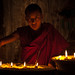 tibetan monk, caring for butter lamps by nahlinse