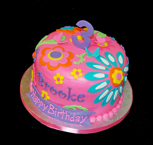 3rd birthday colorful floral patterned cake