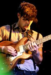 slide guitar(0.0), singing(0.0), bassist(1.0), string instrument(1.0), musician(1.0), performing arts(1.0), music(1.0), guitarist(1.0), guitar(1.0), jazz guitarist(1.0), entertainment(1.0), performance(1.0), bass guitar(1.0), string instrument(1.0),