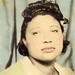 Tinted photobooth image of a black woman