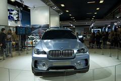 wheel(0.0), bmw x5(0.0), automobile(1.0), automotive exterior(1.0), bmw(1.0), exhibition(1.0), sport utility vehicle(1.0), vehicle(1.0), automotive design(1.0), auto show(1.0), bmw x5 (e53)(1.0), bumper(1.0), bmw x6(1.0), land vehicle(1.0), luxury vehicle(1.0), motor vehicle(1.0),
