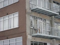 window, sash window, handrail, property, house, window covering, real estate, facade, apartment, home, brickwork, balcony,