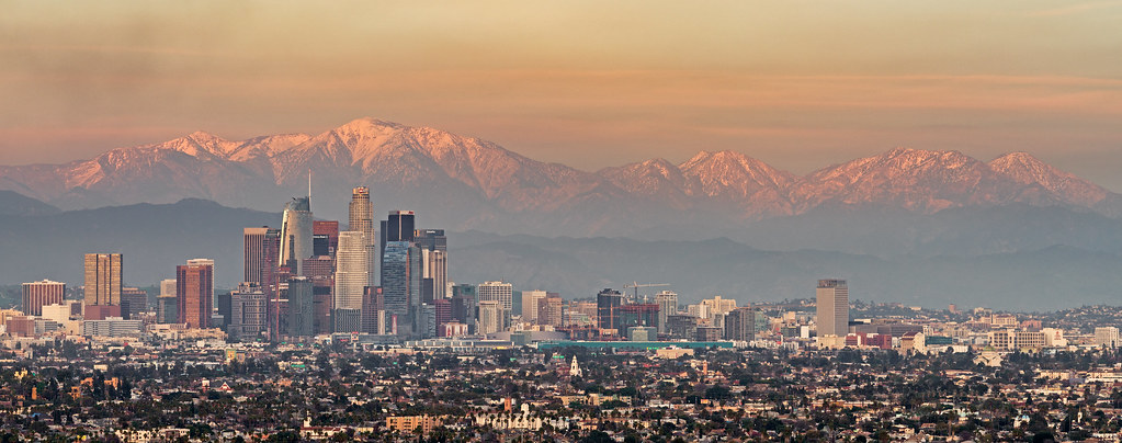 snowy mountains and downtown Los Angeles