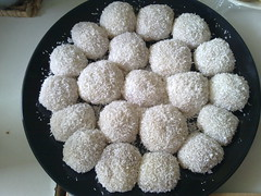 coconut(0.0), chocolate truffle(0.0), produce(0.0), dessert(0.0), glutinous rice(0.0), powdered sugar(0.0), chokladboll(1.0), laddu(1.0), rum ball(1.0), food(1.0), dish(1.0), cuisine(1.0),