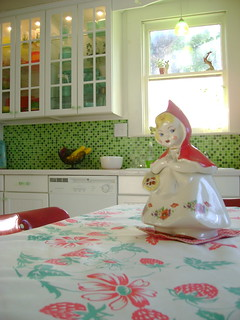 little red cookie jar on vintage tablecloth