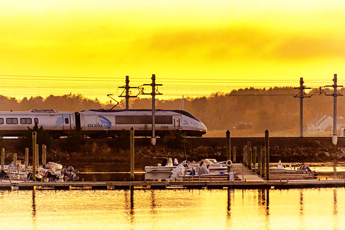 acela connecticut england new stonington altered amtrak art artistic cloud color commute destination image landscape manipulation nature orange photo photograph priint rail reflection scenic serene silhouette sky sun sunset surreal tourism train travel tree water yellow