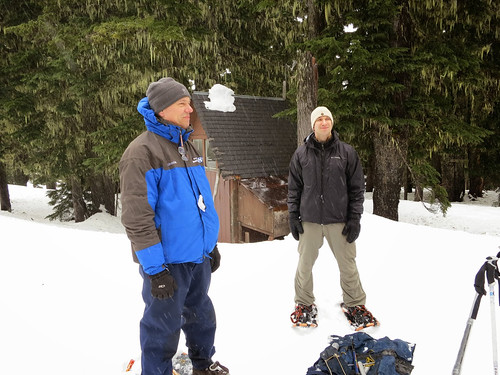 A Portland television reporter and NRCS public affairs specialist Spencer Miller join NRCS snow surveyors to measure snow and collect data.